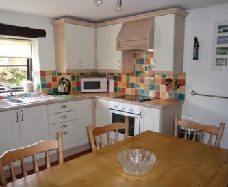 The kitchen in Well Park Cottage