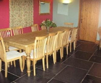 Dining room table comfortably seating 12
