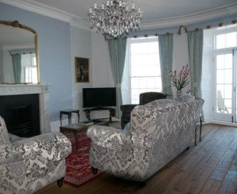 Drawing room with original marble fireplace
