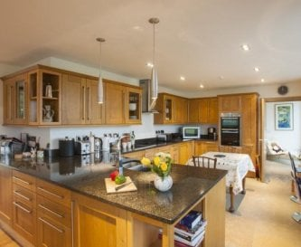 fantastically well equipped kitchen area open plan
