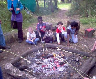 cooking on a camp fire, fun along with education