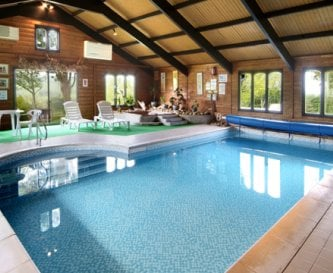 indoor pool with spa and sauna