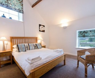 Bedrooms in Rakes Cottage have traditional beams