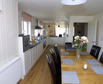 Looking from the dining room to the kitchen