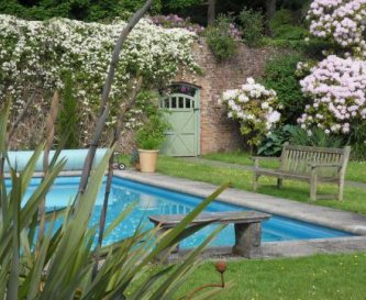 Open air swimming pool beside Pavilion Cottage