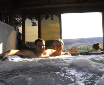 Enjoy the Jacuzzi hot tub with countryside view