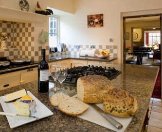 The Kitchen - with 4-oven Aga, double oven & hob
