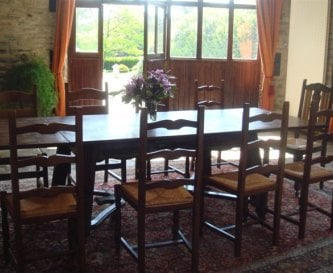 Large dining area leading to garden and BBQ