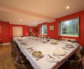 Red dining room at Tone Dale House