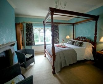 Master bedroom with romantic four poster bed.