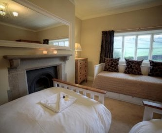 Bedroom 4 with twin beds and extra day bed.
