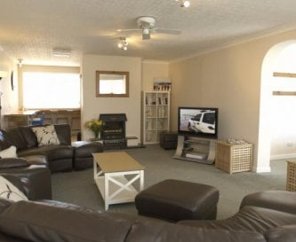 Spacious comfortable lounge with large TV & wi-fi.