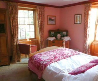 One of the smaller main house bedrooms
