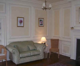 Lounge with original panelling, open fire