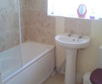 Bath with shower over and WC, refurbished 2011