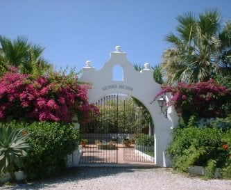 Entrance to the patio  around which are 4 villas