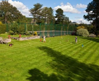 Lawned gardens with Tennis Court and play area