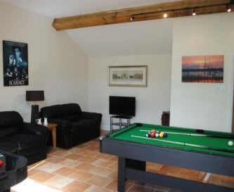 Games include pool, air hockey and table football