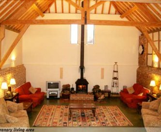 Granary living with 5 large sofas and log burner
