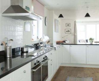 Open plan kitchen looking through to sitting room