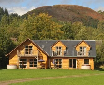 Two adjoining lodges with hot tubs
