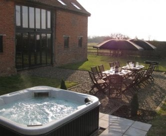 Private hot tub in enclosed garden with patio