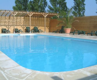 Sheltered, heated swimming pool.