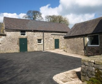 Enclosed yard with ample parking for guests