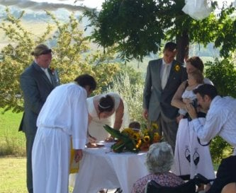 Ceremony held by the pool, under the pergola
