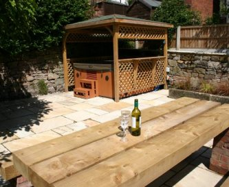 Landscaped garden with luxury hot tub and seating