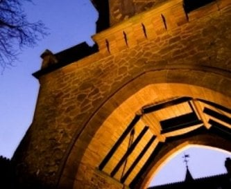 Evening image of the arch way into the courtyard